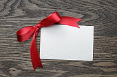 red bow with paper card