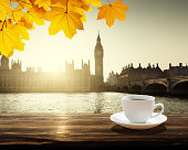 Big Ben at sunset and cup of coffee, London, UK