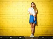 Trendy Hipster Girl at the Brick Wall