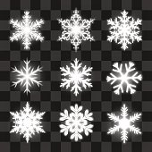 Glowing snowflakes on the transparent background.