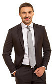 Well-dressed man. Charismatic businessman standing on white background