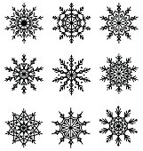 Black Flat Lacy Snowflakes Icons Isolated on White