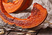 Slices of roasted pumpkin and seeds close up