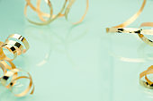 Gold bow on light background. Abstract holiday background