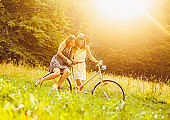 Teenage friends having fun and cycling together