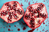 Close-up of pomegranate slices on messy cutting board