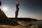 Below view of sensual woman on the beach in summer.
