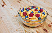 Corn flakes with fresh berries in bowl
