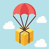 Delivery concept. Brown box floating in blue sky with parachute