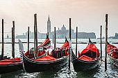 Red Gondolas in Venice, San Giorgio di Maggiore church, Italy