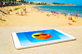 icon of a sun sweating in a tablet computer