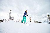 Practicing snowboarding