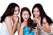 Group of girls reading message on cellphone