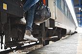 Unrecognizable person leaving the train.