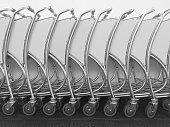 Row of Luggage carts at airport
