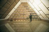 Businessman in loft library