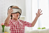 girl playing game in virtual reality glasses