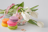 Tulips and Jar full of marshmallow and colored macaroons