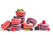 Colorful macaroons with fruits on white background