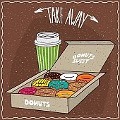 Donuts in carton box and paper cup of coffee