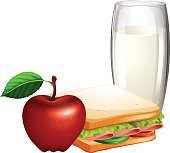 Breakfast set with sandwiches and milk
