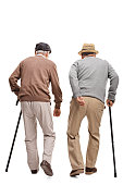 Two elderly people walking with canes isolated on white backgrou