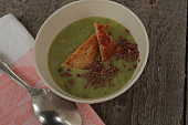 cream of broccoli soup with croutons and flax seed.