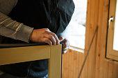 Worker preparing to install new three pane wooden windows