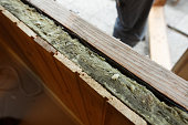 Exposed drywall insulation during window change