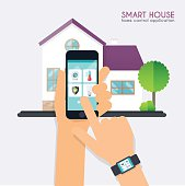 Smart house. Home control application concept. Hand holding smar