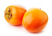 two fresh ripe persimmons