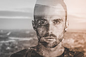 Double exposure portrait of a man and city