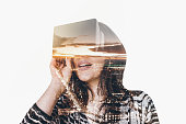 Double exposure of woman wearing virtual reality simulator