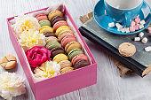 Colorful macaroons, coffee. Sweet macarons
