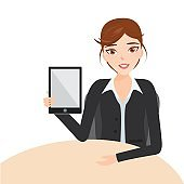 Beautiful brunette business woman using a touch pad tablet porta