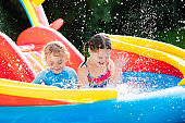 Children playing in inflatable swimming pool
