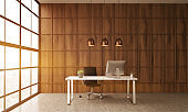 Office table in room with wooden wall