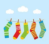 colorful bright socks on a rope with clothespins against