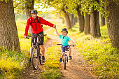 Father and son cycling in the countryside