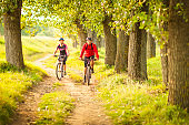 Happy couple cycling in the countryside