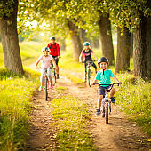 Happy family cycling in the countryside