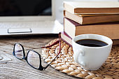 Reading books with coffee on table