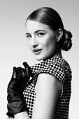 Retro girl in dress and gloves