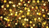 Abstract background with bokeh effect in gold