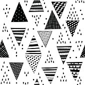 Seamless pattern with decorative hand-drawn triangles. Vector black-white  geometric background.