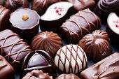Assortment of fine candies, white, dark, milk chocolate Sweets background