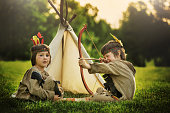 Cute portrait of native american boys with costumes, playing out