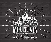 Mountains handdrawn sketch emblem. outdoor camping and hiking, vector