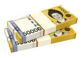 Stack of 50000 won bills isolated on white