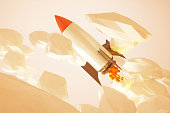 Rocket in gold sky startup